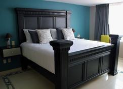 恩特雷庭院精品酒店 - 利昂 - 睡房