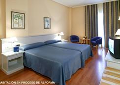 蒙泰波尔塔提亚拉酒店 - 加的斯市 - 睡房