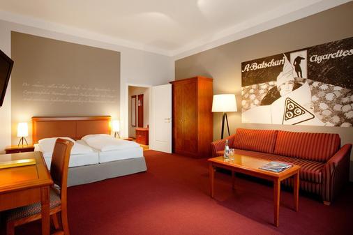 安科纳生活巴沙利 8 号酒店 - 巴登-巴登 - 睡房