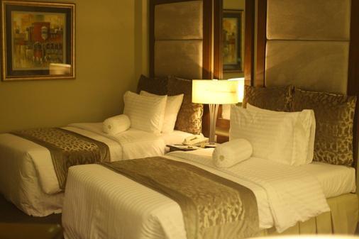 拉合尔款待旅馆 - 拉合尔 - 睡房