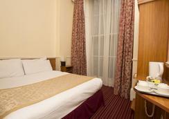 Reem Hotel - 伦敦 - 睡房