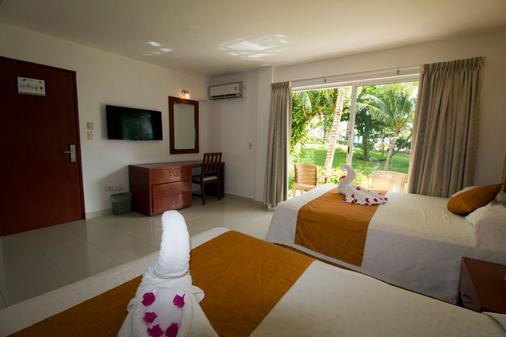 坎昆普拉亚斯瑟鲁斯马酒店 - 坎昆 - 睡房