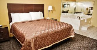 温彻斯特套房饭店 - 汉布尔/乔治·布希洲际机场/北休斯顿 - 亨博尔 - 睡房