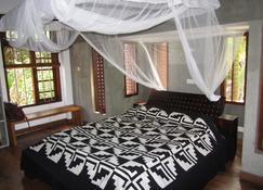 伊萨纳海滩旅馆 - 坦加拉 - 睡房