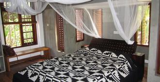 伊萨那海滨别墅 - Tangalla - 睡房