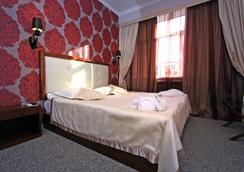 Evropa Hotel - 比什凱克 - 睡房