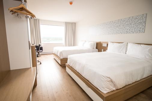 乐纳威戈特酒店 - 里穆斯基 - 睡房