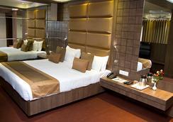 Hotel Centre Point - 那格浦尔 - 睡房