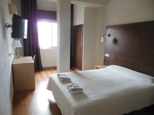 伊姆巴加多酒店 - 阿尔梅利亚 - 睡房