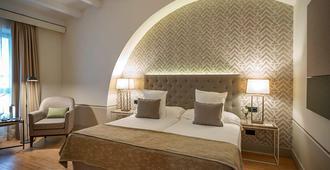 阿雷纳莱斯宫殿霍斯皮斯及spa酒店 - 卡塞雷斯 - 睡房