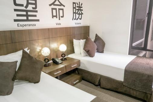 费利亚公寓式酒店 - 波哥大 - 睡房