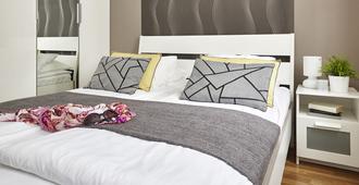 布达佩斯七季公寓酒店 - 布达佩斯 - 睡房