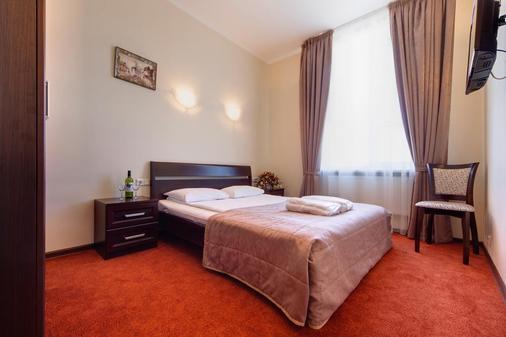 索洛潘诺拉马酒店 - 圣彼德堡 - 睡房