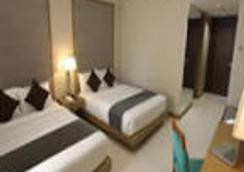 皇冠丽晶酒店和会议中心 - Malay - 睡房