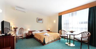 T&T酒店 - 波兹南 - 睡房