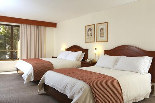 内鲁达酒店 - 圣地亚哥 - 睡房