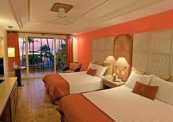 塔玛琳多迪里亚海滩度假酒店 - Tamarindo - 睡房