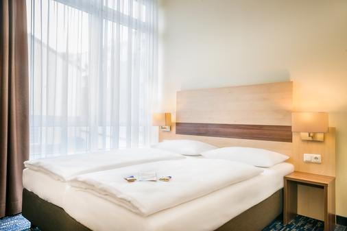 科隆机场美居酒店 - 科隆 - 睡房