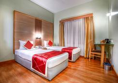 Hotel Sitara - 海得拉巴 - 睡房