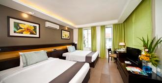 新海岸高尔夫海滩度假村 - Malay - 睡房