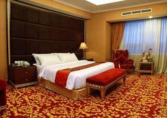 巴斯科高级酒店 - 巴东 - 睡房