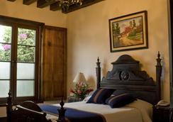 罗德里格安提瓜波萨达酒店 - 安地瓜 - 睡房