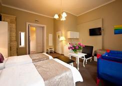 塞拉利昂公寓式酒店 - 克拉科夫 - 睡房