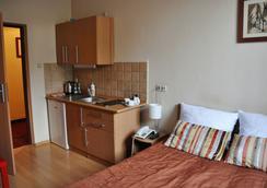 玛利克拉科夫公寓酒店 - Krakow - 睡房