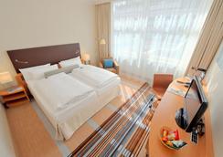 科隆贝尔福街美居酒店 - 科隆 - 睡房