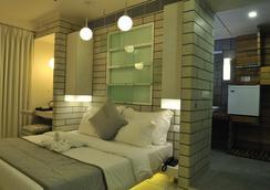 埃尔多拉多酒店 - 艾哈迈达巴德 - 睡房