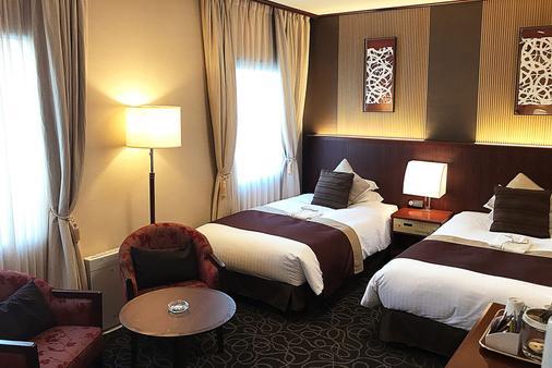 石埠亚克里斯顿酒店 - 东京 - 睡房