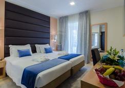 美式罗西奥酒店 - 里斯本 - 睡房