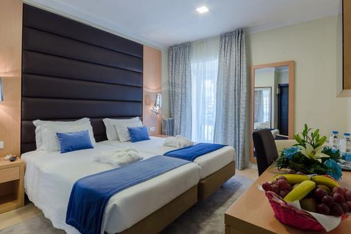 罗西奥旅馆酒店 - 里斯本 - 睡房