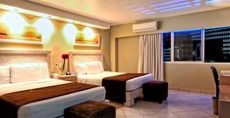 利安德格拉纳达城市酒店 - 巴拿马城 - 睡房
