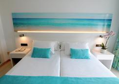 伊潘内玛海滩酒店 - 埃尔阿雷纳尔 - 睡房
