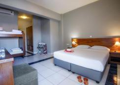 奈普图诺海滩酒店 - 伊拉克里翁 - 睡房
