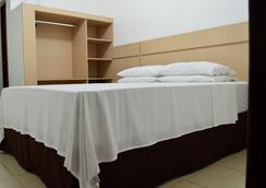 Richard Hotel - 波多韦柳 - 睡房