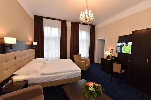 文豪斯沃勒酒店 - 什未林 - 睡房
