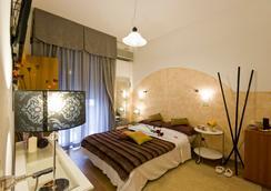 遗产酒店 - 里米尼 - 睡房