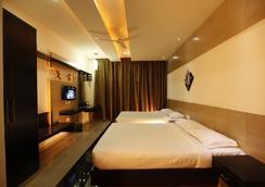 Fabhotel Arafa Inn Gandhinagar - 班加罗尔 - 睡房