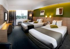 玛格丽特大酒店 - 古晋 - 睡房