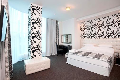 迈如泰尔酒店 - 克拉斯诺达尔 - 睡房