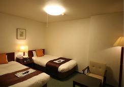 凯塔酒店 - 盛冈市 - 睡房