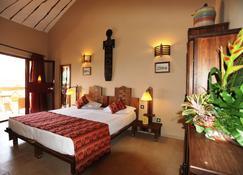 拉曼亭海滩度假酒店及spa - Mbour - 睡房