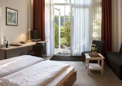 欢乐田园酒店 - 柏林 - 睡房