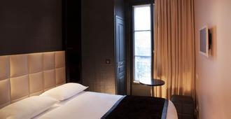 巴黎艾菲尔铁塔之旅第一酒店 - 巴黎 - 睡房