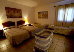 莫德诺酒店 - 奥尔比亚 - 睡房
