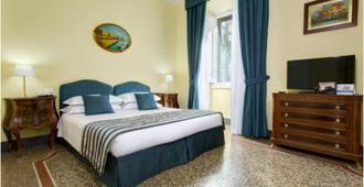 皮拉姆温馨酒店 - 罗马 - 睡房