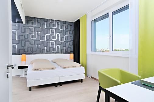 慕尼黑哈利之家公寓酒店 - 慕尼黑 - 睡房