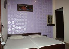 阿格拉熊猫好友背包客酒店 - 阿格拉 - 睡房